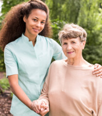 caregiver with an elderly woman, outdoors