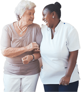 Friendly nurse and female senior patient looking at each other